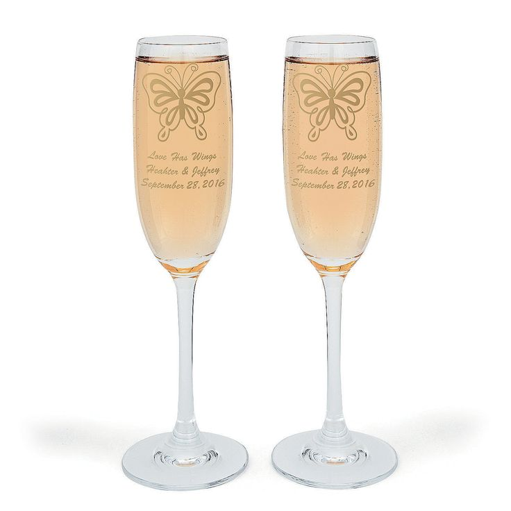 "Personalized All Aflutter Flutes - OrientalTrading.com ""Love has Wings"" names & date, set of 2, $16"