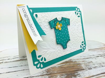 A baby card using the Stampin' Up! Made with Love stamp set. #babysfirstframelits, #babycard, #congratulationscard, #curvycornertriopunch, #onesie, #pinkblingcrafter, #normapimentel,