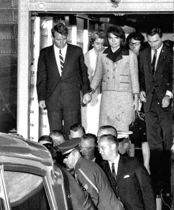 *JFK's body arrives back in Washington on November 22, 1963 at around 5 pm.  Behind Jackie are her secretary Mary Gallagher (left) and JFK's secretary Evelyn Lincoln (right).
