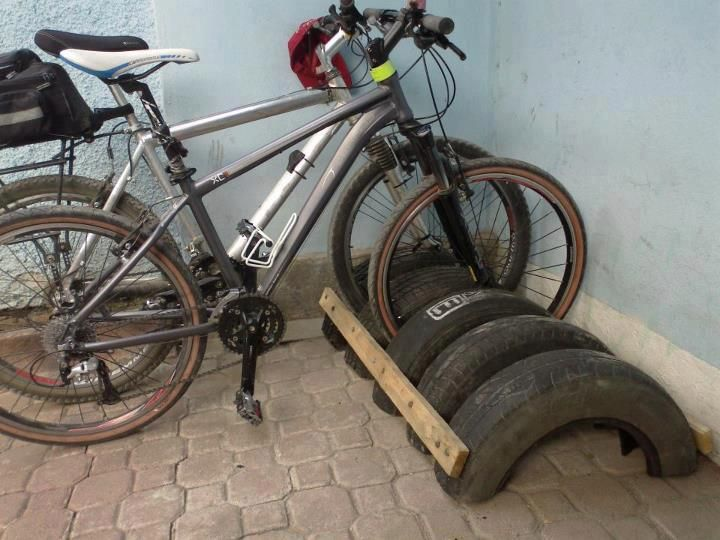 Old tires, some nails and 2 pieces of scrap wood = Multi-bike rack and less trash in landfills.