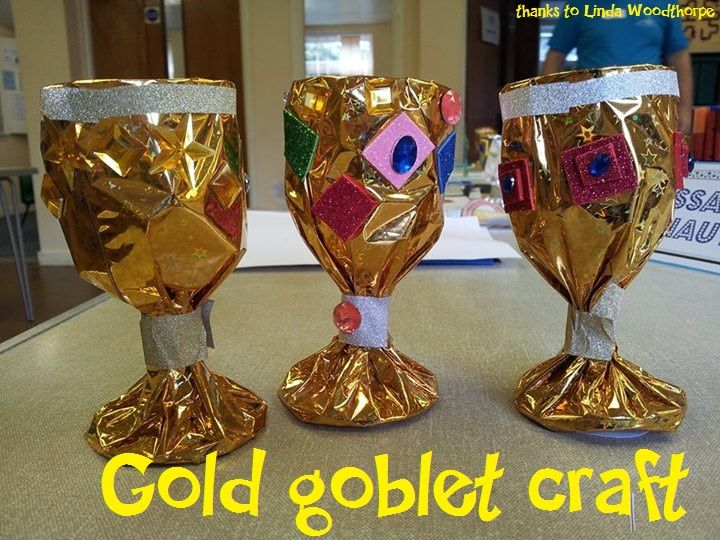 medieval gold goblet craft - wrap metallic wrapping paper around a dollar store plastic goblet, stick on gems and other sparkly things :)  (thanks to Linda Woodthorpe)