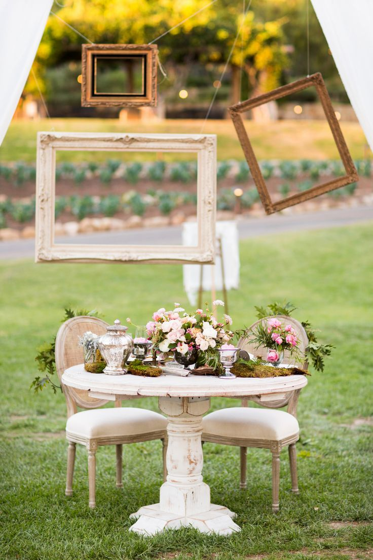 Wedding Decor - Hanging Frames for Alternative to Photo Booth. See more of this whimsical wedding here: http://www.StyleMePretty.com/little-black-book-blog/2014/05/20/whimsical-ojai-valley-wedding/ Photography: Jonathan Young - jyweddings.com