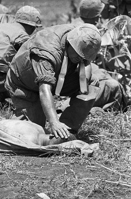 05 Jul 1967, Con Thien, South Vietnam. Con Thien, South Vietnam: A Marine chaplin says the Last Rites for a dying soldier south of the Demiliarized Zone near here July 4th. A Communist trap built around the bodies of American dead cost the Marines 21 killed and 40 wounded. It pushed to 79 the number of Marines killed along the northern border since July 2nd. 7/5/1967. © Bettmann/CORBIS