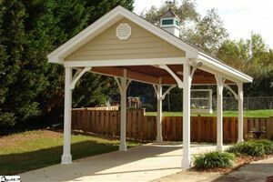need two car Carport: or maybe just build carports for front and back, Steve is going to want to park his truck/ trailer in the back yard, find out if we need approval from the city? When building the fencing make sure to make gates to open up at the side, and build something like this to house his truck?