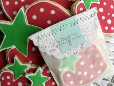 Wrap cookies in glassine bags, stamp tags and layer them over tissue doilies. One stitch across and everything stays put.