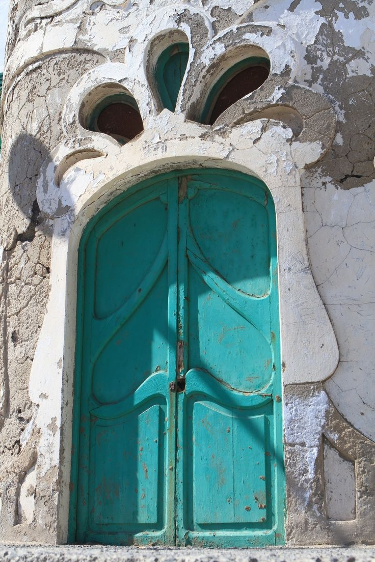 Turquoise door...so rustic looking!