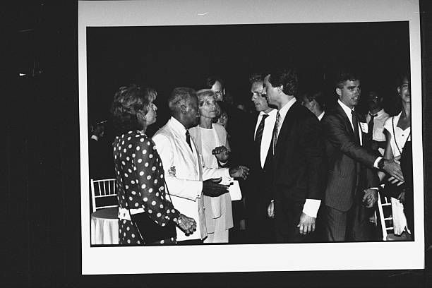 NYC Mayor David Dinkins chatting w Eunice Shriver Joseph Kennedy Bobby Kennedy Jr at the Reebok party for Dem supporters during the wk of the Dem...
