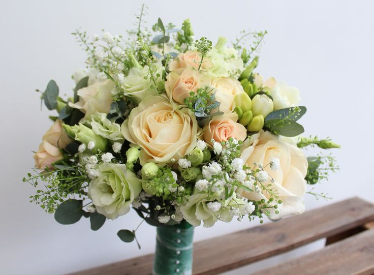 Cottage garden tight hand tie bridal bouquet with the most beautiful Avalanche Roses, Lisianthus, Freesia, Thlaspi, Gypsophila and spray Jana Roses. Wedding flowers at Oor Fleurs