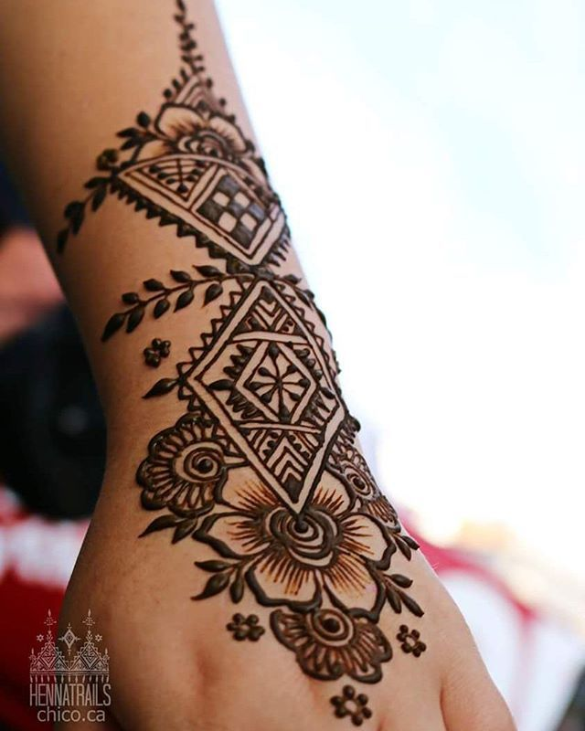 She liked Moroccan style henna and flowers....perfect match combination. Geometric motif and flowers can be found in countless textiles and adornment accoutrements across our world.