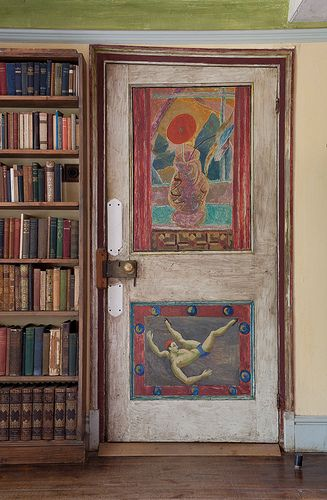Clive Bell's study door. The top panel of the door was painted by Duncan Grant around 1917 and the bottom panel of the door, also painted by Grant, in 1958- replaced a damaged earlier work.