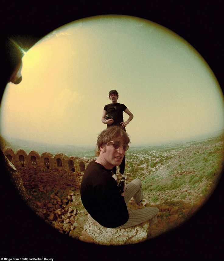 On tour: McCartney and Lennon photographed relaxing near Delhi on a tour of India in July ...