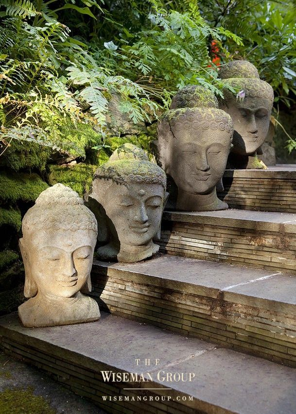 Stone Buddha heads on each step...what an interesting garden element !