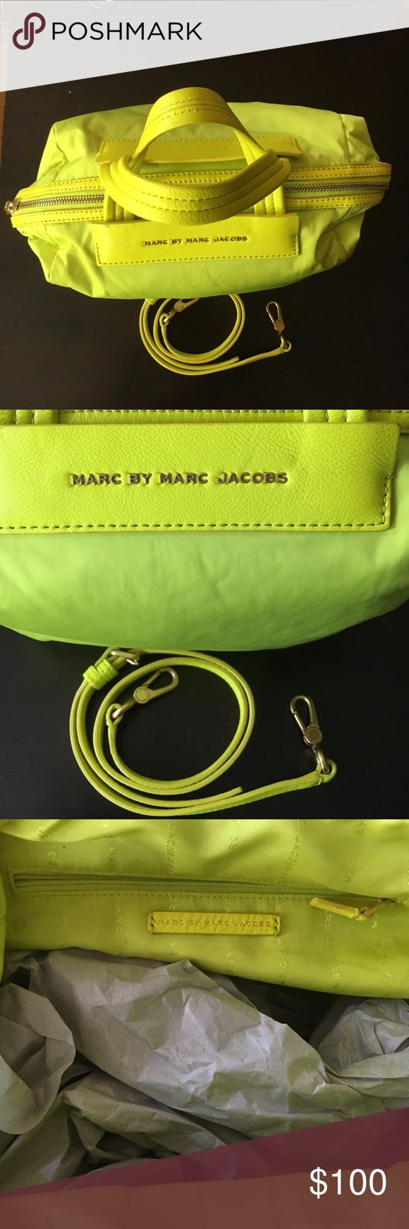Nylon & Leather Marc by Marc Jacobs Bag Authentic Neon Yellow Medium Nylon & Leather Marc by Marc Jacob Bag. Used twice Like new.. No damage. Detachable strap. Gold tone hardware, inside pocket. (Won't last long) Marc by Marc Jacobs Bags Shoulder Bags