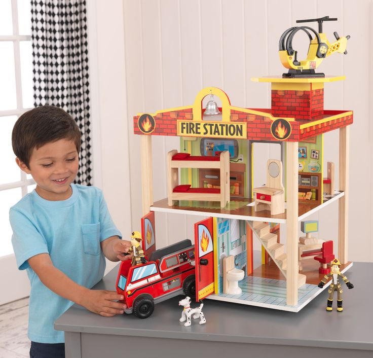 Young boys and girls will love pretending they are real-life heroes with our adorable Fire Station. This play set is full of fun details like the helipad on the roof and garage doors that open and clo