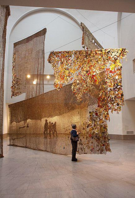 Installation by Ghanaian artist El Anatsui (b.1944) at the Brooklyn Museum (2013). via Garrett Ziegler on flickr