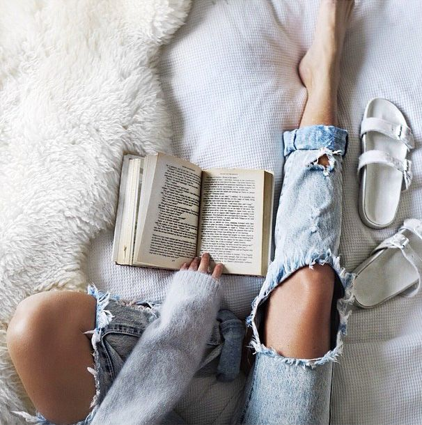 in bed with book