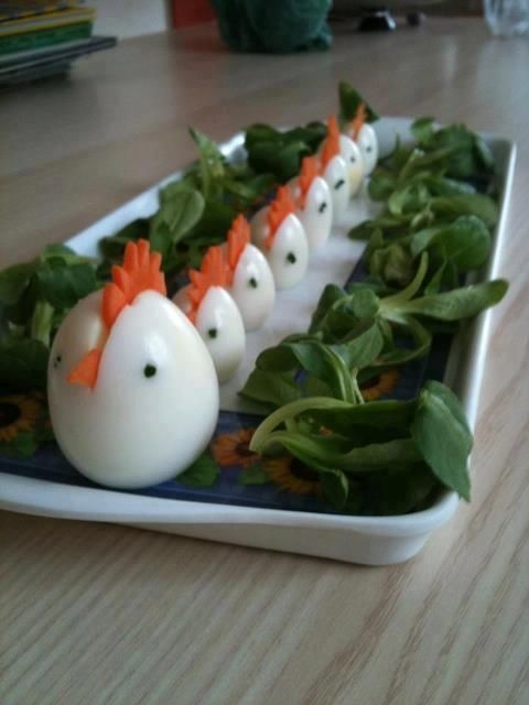 Simple , Hard-boiled Chicken Eggs! - Slice a carrot comb and beak - Slice a bit off the bottom for a flat surface on which to stand - Sitting upright, slice the egg down about 1/2 inch to gently insert the carrot piece - Add black peppercorns to each side of the egg for eyes. http://www.communitychickens.com/
