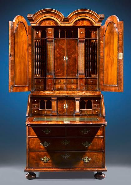 George I walnut secretaire is one of the most astounding and significant examples of fine English furniture we have had the pleasure to offer. A remarkable example of early Georgian furniture, this secretary is crafted entirely of sturdy walnut with burl walnut veneer, and exhibits the careful artistry of a master craftsman. 1720