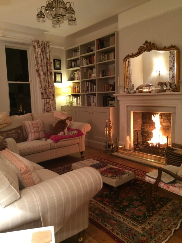 Formal yet cozy living room with a roaring fire.