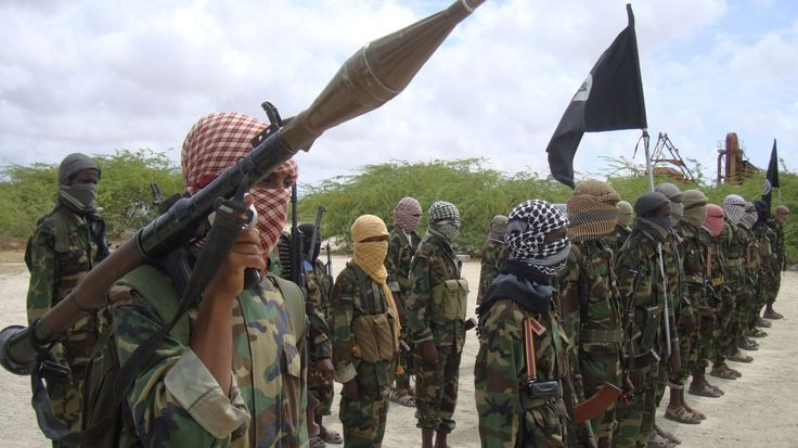 Armed group says it killed 57 soldiers at an army base in Somalia, while Kenya says