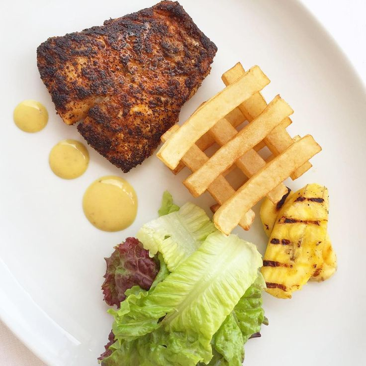 Ocean to table at Cobblers Cove. Freshly caught Mahi Mahi, blackened and served with local greens, potato chips & grilled plantain.  #cobblerscove #barbados
