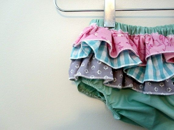 Ummm, can i get 20 of these?!?!? I'm in love! @Kerrie Knox you'll love this.    Mermaid Princess  Wrap around ruffle diaper covers by RaeGun, $16.50