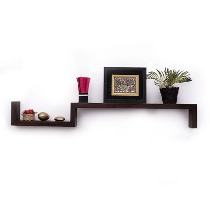 Uno Odda Wall Shelf - Glamorous and Practical! This Odda wall shelf adds a contemporary feel to the living room walls with its geometrical pattern.A wooden structure molded using modern craftsmanship and finished with a walnut shade touch looks classy. Use this durable item to display your books or artifacts and bring novelty to the walls. Salient Features:* An exquisite item that has been handcrafted and boasts of refined craftsmanship * Crafted from superior quality solid wood* A home ...