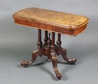 "Lot 1086 A Victorian inlaid figured walnut D shaped card table, raised on 4 turned columns, splayed legs 28""h x 35 1/2""w x 17 1/2""d £450-550"