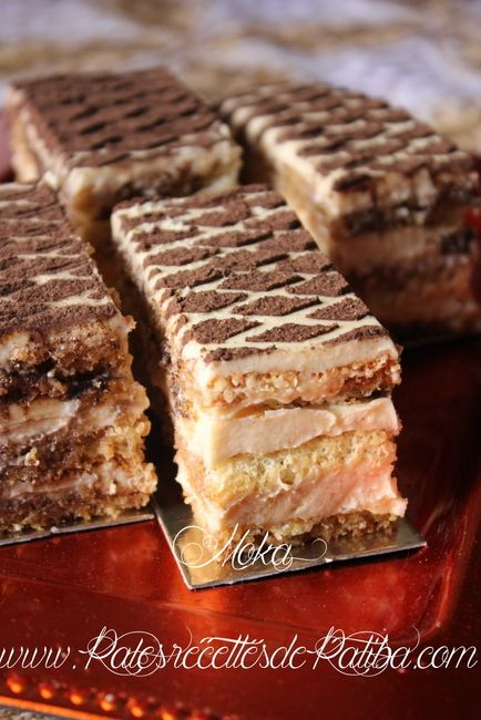 Bonjour le moka est un gâteau classique de la pâtisserie française il s'agit tous simplement d'une génoise imbiber d'un sirop au gout du café et une délicieuse creme au beurre au gout caféet pour le rendre plus léger j'ai du remplacée la creme au beurre par une délicieuse mousseline pralinée  Inrédients pour les disques …Read more...