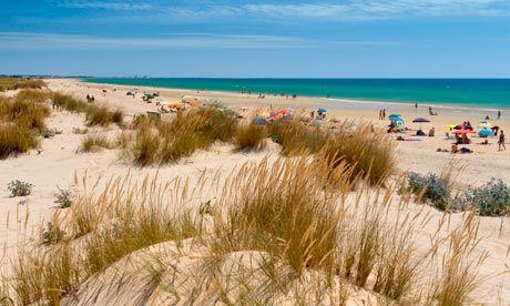 Cabanas beach, near Tavira, Portugal. Photographs: Alamy
