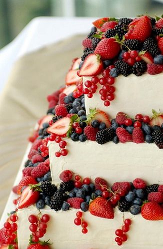 Summer wedding cake, decorated with colorful fruit! you could also decorate with chocolate covered strawberries!