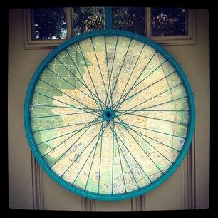 At a.m.o., we don't do traditional wreaths.  We do salvaged bike wheel + map 'wreaths'.
