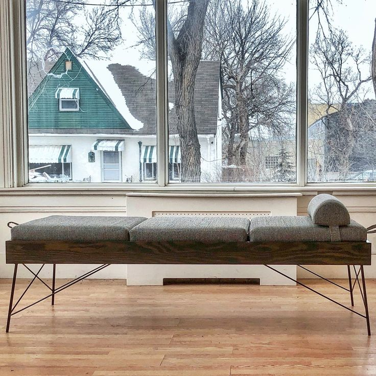 Siesta daybed in slate grey yeeed upholstery over ebony stained fir wood frame.