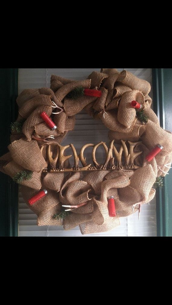 A hunting wreath with antlers and shotgun