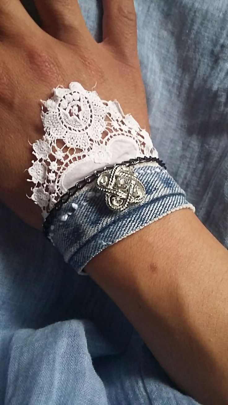Handmade bracelet/cuff, with antique lace and vintage button. the closure is adjustable. Made by me