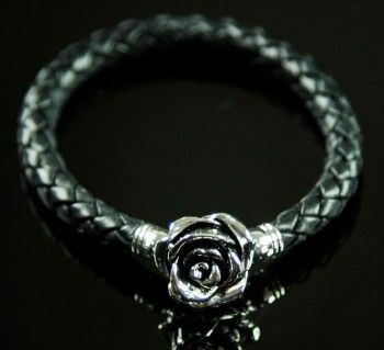 Our fantasy rose bracelet, in black leather with an antique rose charm is striking on its own, or team with two or three of our other bracelets for a great layered look.