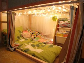 Under-bed / loft style kid's fort with pillow mattress, bookshelves and string lights