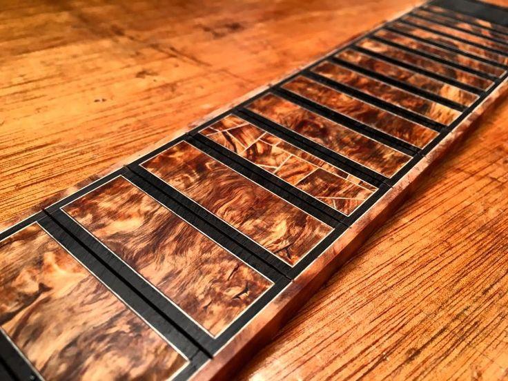 Burl fretboard inlay