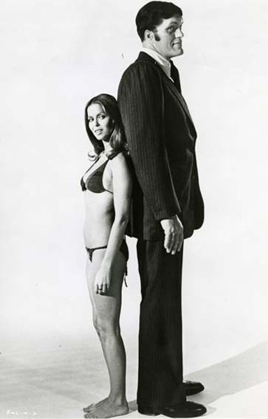 Barbara Bach and Richard Kiel in The Spy Who Loved Me (1977, Bond #11) starring Roger Moore & Barbara Bach  *wiki: http://en.wikipedia.org/wiki/List_of_James_Bond_film *imdb: http://www.imdb.com/list/sVMEsl9MnOY/