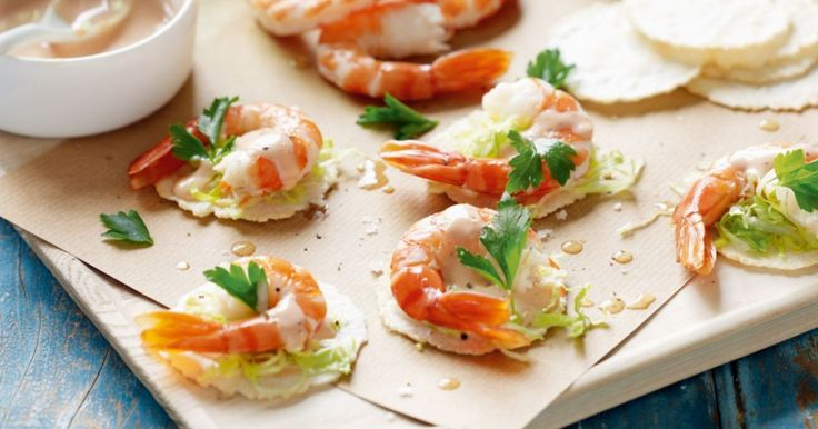 Feed a crowd with bite-sized prawn cocktail canapes - crisp, fresh bites lightened up with cocktail sauce and iceberg lettuce on wafer-thin crispbreads.