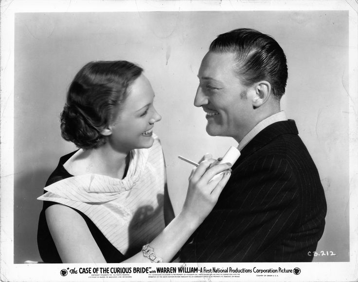 Claire Dodd as Della Street, Warren William as Perry Mason in The Case of the Curious Bride (1935).  From the Jim Davidson Collection.