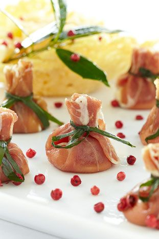 Prosciutto purses filled with Mascarpone cheese, drizzled with truffle oil and tied with a chive ribbon from Windows Catering