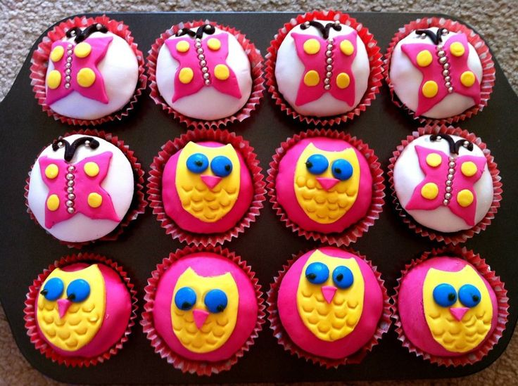 Butterfly and owl cupcakes.