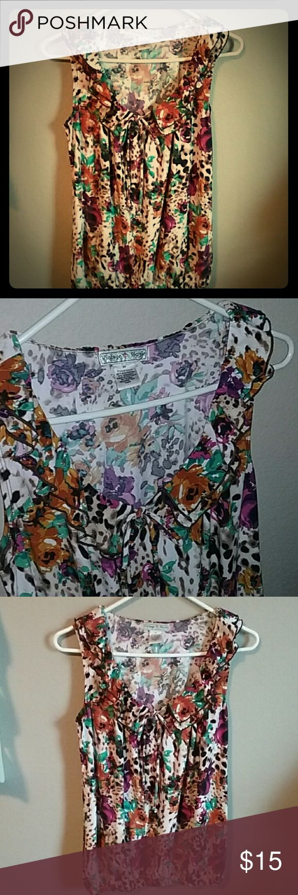 """Great Sleeveless Soft Like New Shirt Adorable!  Like new! Great floral, animal print pattern with a tie at the neckline and a gathered waist. Cute ruffles around the neckline;)  Size Medium! Almost tunic length! 27"""" from shoulder to hem.  Smoke and pet free! Feel free to make offers! Thank you! xo Vintage Suzie Tops Blouses"""