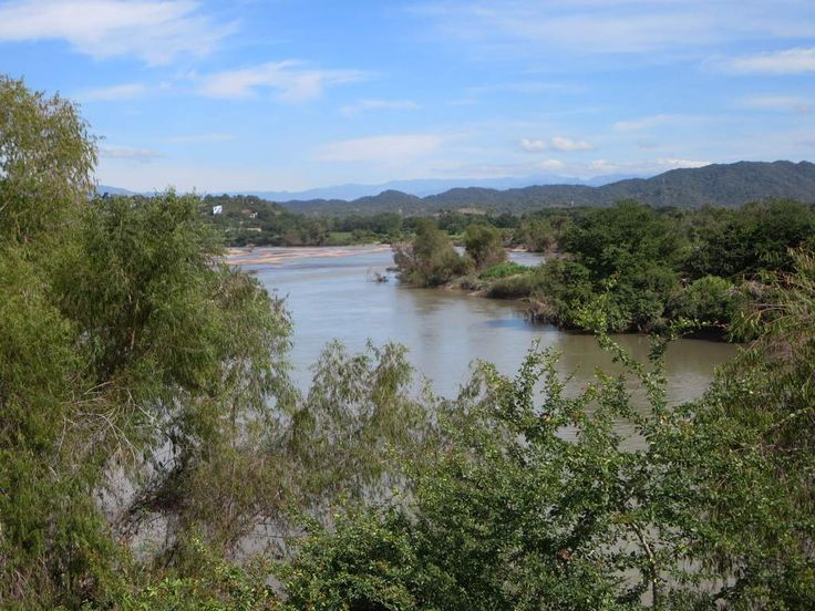 The Rio Baluarte passes alongside El Rosario, Sinaloa, Mexico, on its way from Parque Natural Mexiquillo to the Pacific Ocean.