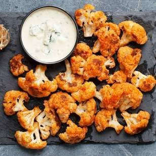This recipe for spicy Buffalo cauliflower bites is a great vegetarian alternative to Buffalo wings. Roasted cauliflower stands in for chicken and provides more fiber and fewer calories. Serve this easy appetizer with carrot sticks, celery and your favorite ranch or blue cheese dressing for your March Madness snack.