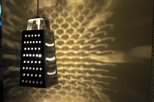 Graters repurposed as lighting.  This is cool