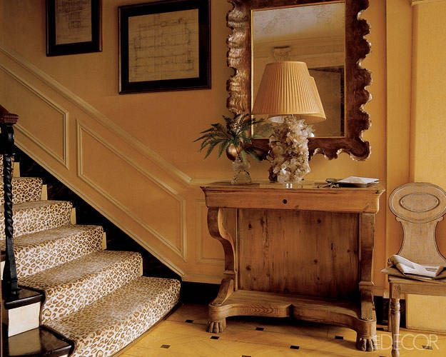 A leopard-print stair runner adds a subtle graphic touch to the entrance of this apartment