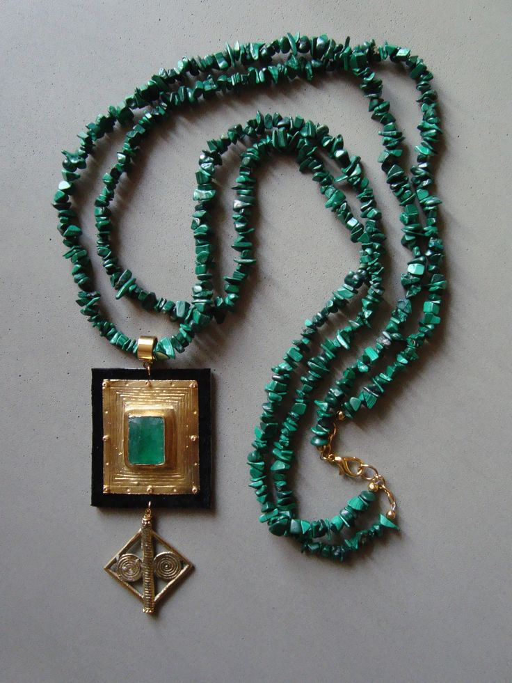 V I R E N T I — Double strand of free form Malachite beads. Black suede and a rectangular Emerald set in vermeil with a brass charm drop. 28 inches long with a 4 inch pendant. — $225.00