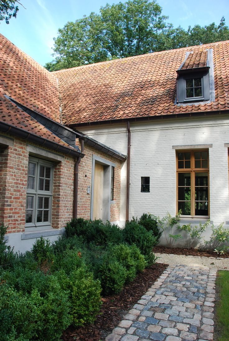 Composition of external textures with stone sett path leading to a traditional farmhouse